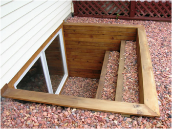 In Bracebridge, Gravenhurst and Muskoka egress window wells can be made of many materials such as this timber framed one with steps.